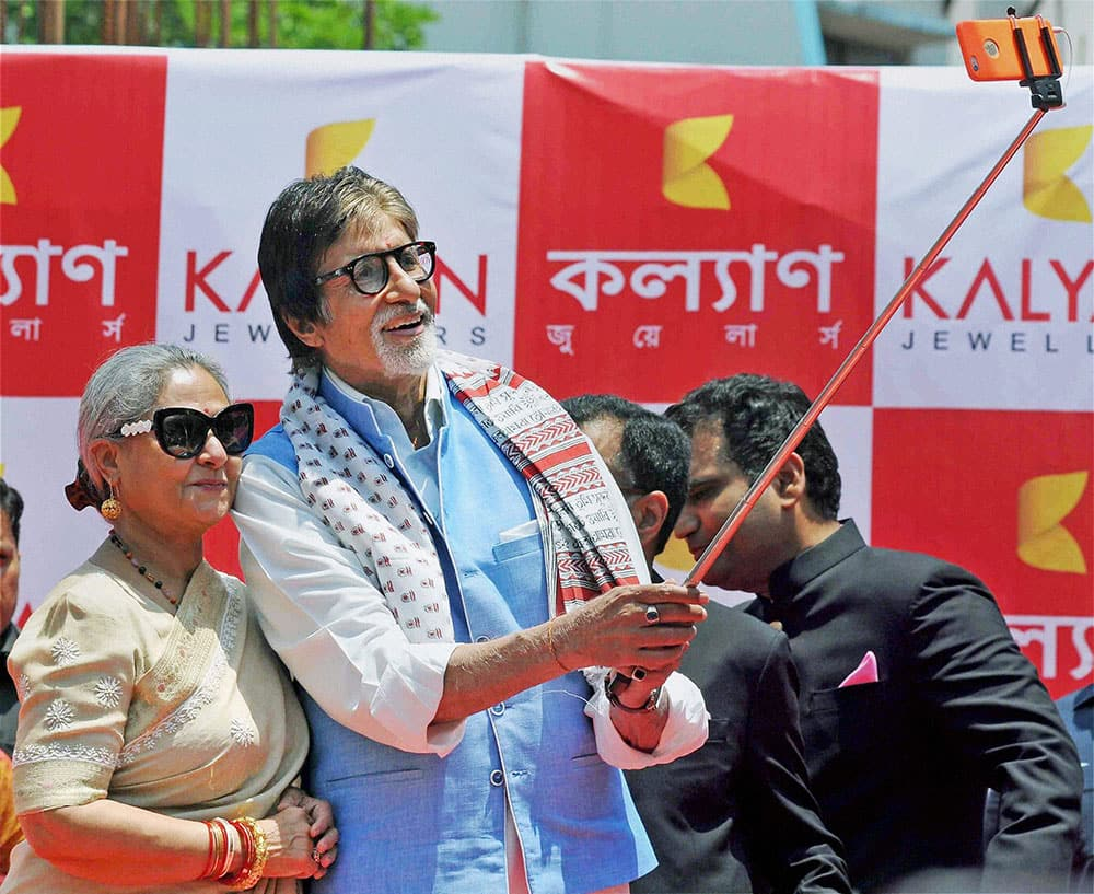 Bollywood actor Amitabh Bachchan takes selfie with wife Jaya Bachchan during the inuaguration of first showroom of Kalyan Jewellers in Kolkata.