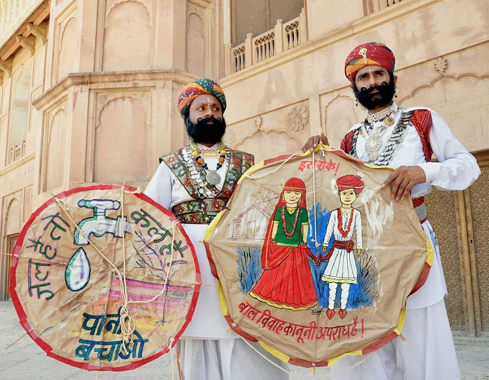 Rajasthani artists take part in an awareness campaign against child marriages on Akshaya Tritiya in Bikaner in Rajasthan.