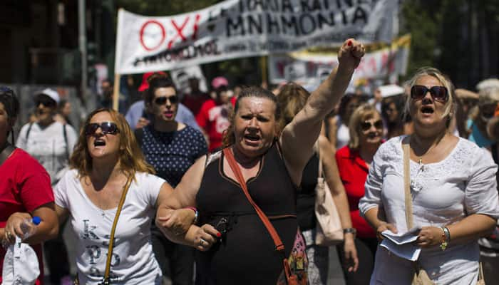 Thousands take to streets in Greece ahead of reform vote