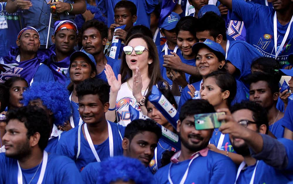 Mumbai Indians owner Nita Ambani with the Education For All underprivileged children who were the special invitees to watch IPL match between Mumbai Indians and Sunrisers Hyderabad in Visakhapatnam.