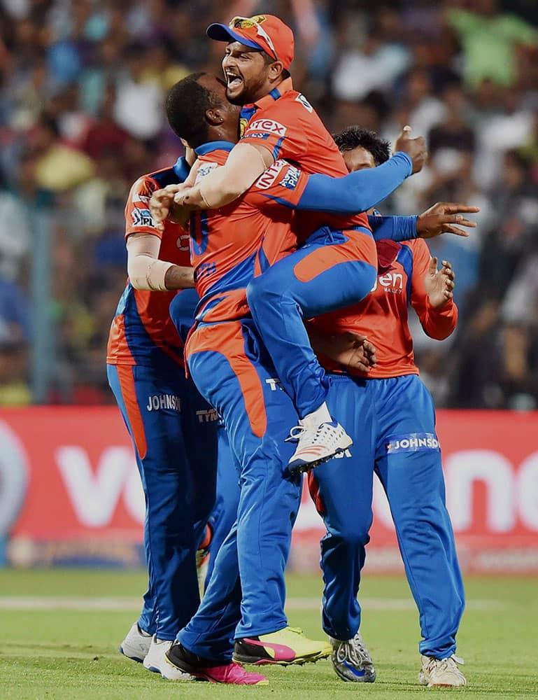 Gujarat Lions Captain Suresh Raina celebrate with team mates after the wicket of KKRs SA Yadav at Eden Garden in Kolkata.