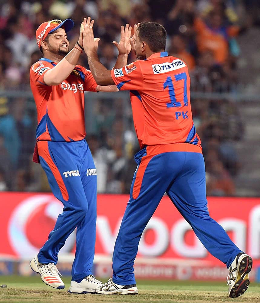 Gujarat Lions bowler Praveen Kumar celebrate with Captain Suresh Raina after the wicket of KKR Captain Gautam Gambhir at Eden Garden in Kolkata.