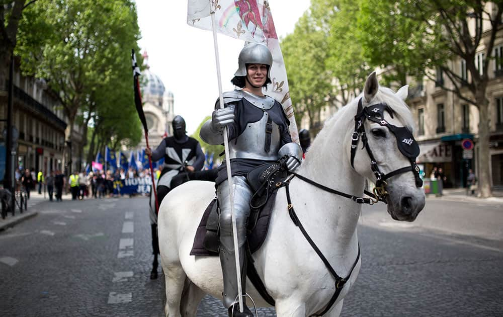 A woman dressed as Joan of Arc sits on a horse during a demonstration commemorating Saint Joan of Arc organized by the fundamentalist Catholic-nationalist Civitas institute in Paris, France.