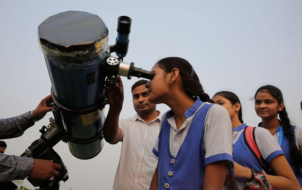 School children line up to look through a telescope the rare transit of Mercury across the sun in Lucknow. NASA says the event occurs only about 13 times a century.