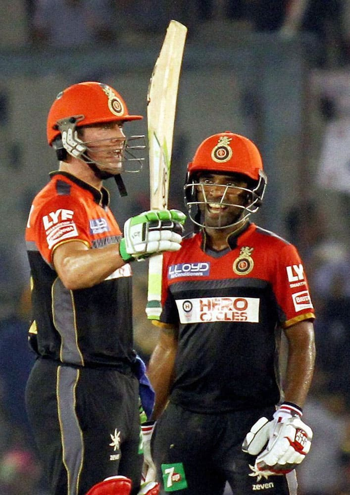 AB De Villiers of Royal Challengers Banglore celebrates his half century during an IPL match against Kings XI Punjab in Mohali.