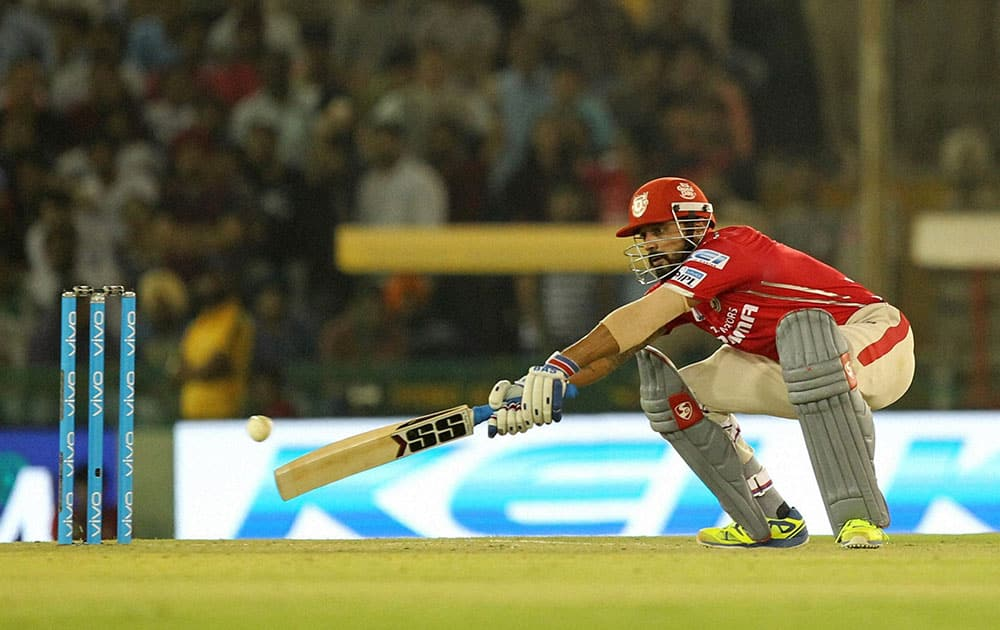 Murali Vijay captain of Kings XI Punjab plays a shot during an IPL match against Royal Challengers Bangalore in Mohali.