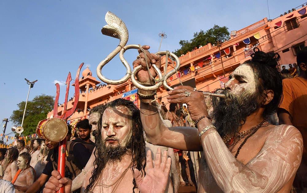 Naga Sadhu and devotees take part in the holy dip on the second Shahi Snan in Kshipra River during Simhastha Maha Kumbh Mela in Ujjain, Madhya Pradesh.