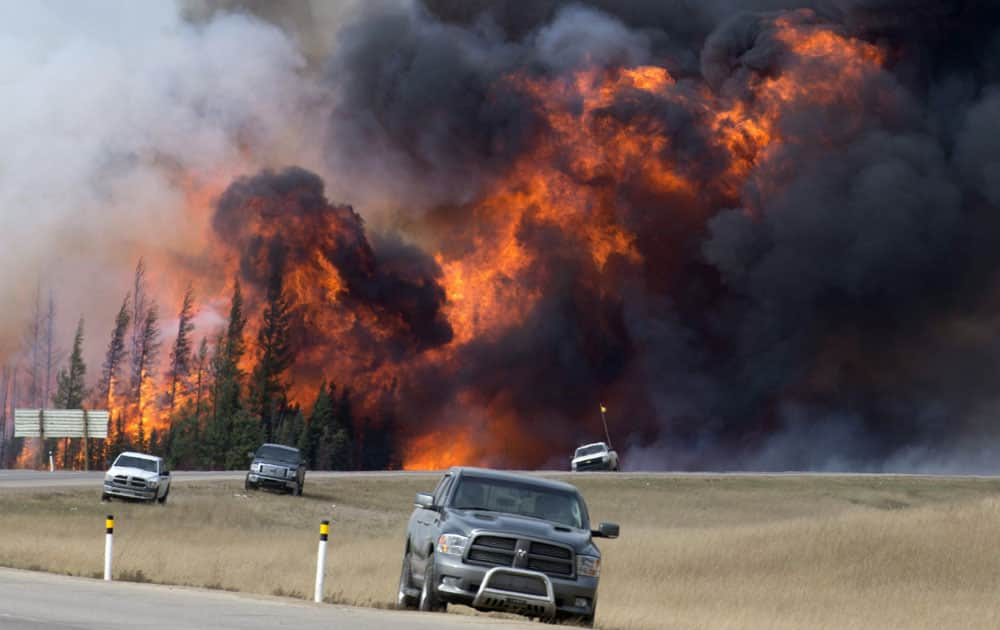 wildfire burns south of Fort McMurray, Alberta. A dry and blistering hot northern Alberta is burning and doing so unusually early in the year,  but that's only the latest of many gargantuan fires on an Earth that's grown hotter with more extreme weather.