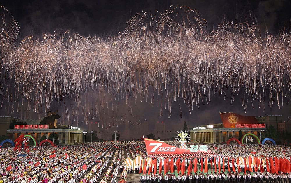 Fireworks explode over the Kim Il Sung Square during a parade in Pyongyang, North Korea.