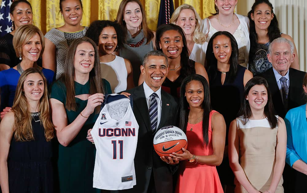 President Barack Obama poses for a group photo with the 2016 NCAA Champion UConn Huskies women's basketball team during a ceremony in the East Room of the White House in Washington.