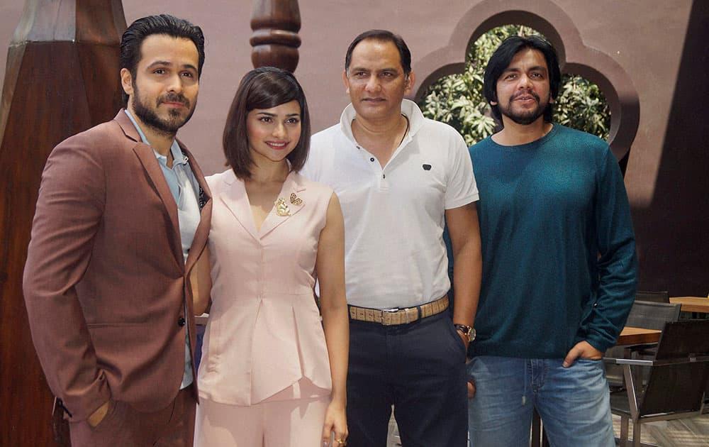 Actors Emraan Hashmi and Prachi Desai with former cricketer Mohammad Azharuddin and director Tony DSouza promote the film Azhar in New Delhi.