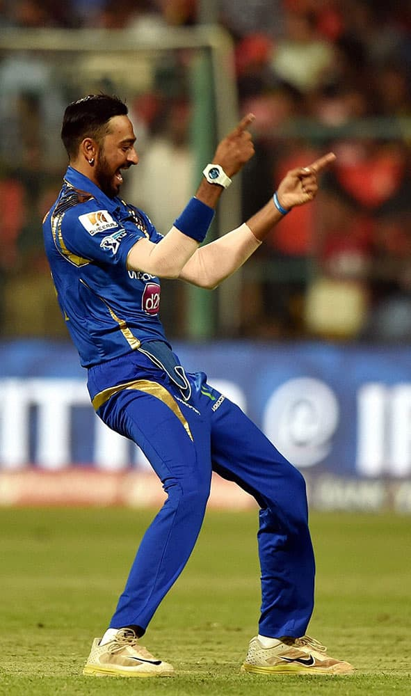 Mumbai Indians bowler Krunal Pandya celebrate the wicket of AB De Villiers during IPL 2016 match against Royal Challengers Bangalore at Chinnaswamy stadium in Bengaluru.