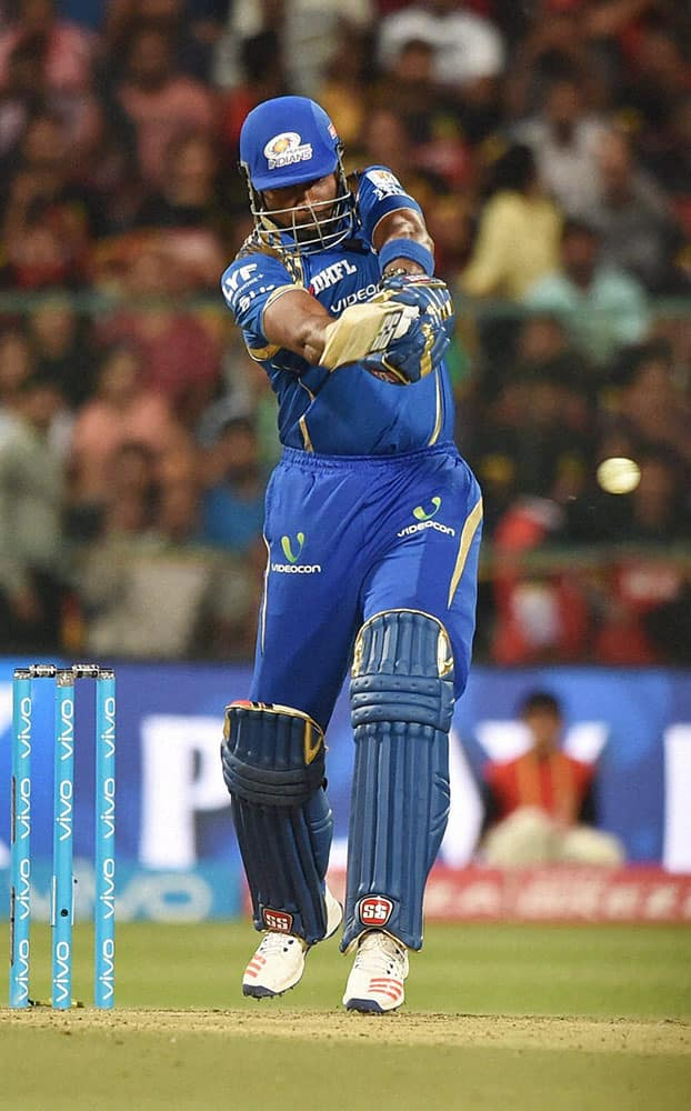 Mumbai Indians batsman Kieron Pollard plays a shot during IPL 2016 match against Royal Challengers Bangalore at Chinnaswamy stadium in Bengaluru.