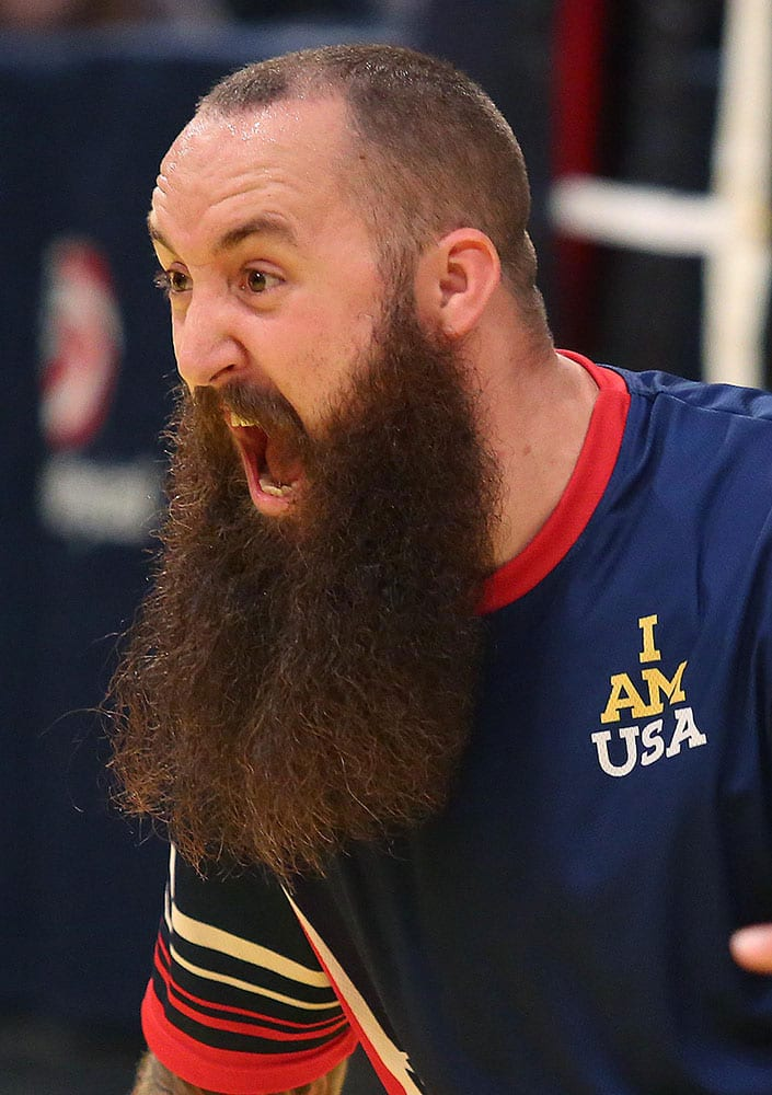 U.S. player Steven Davis screams in celebration during the championship match against Britain in the sitting volleyball competition at the Invictus Games in Orlando, Fla.