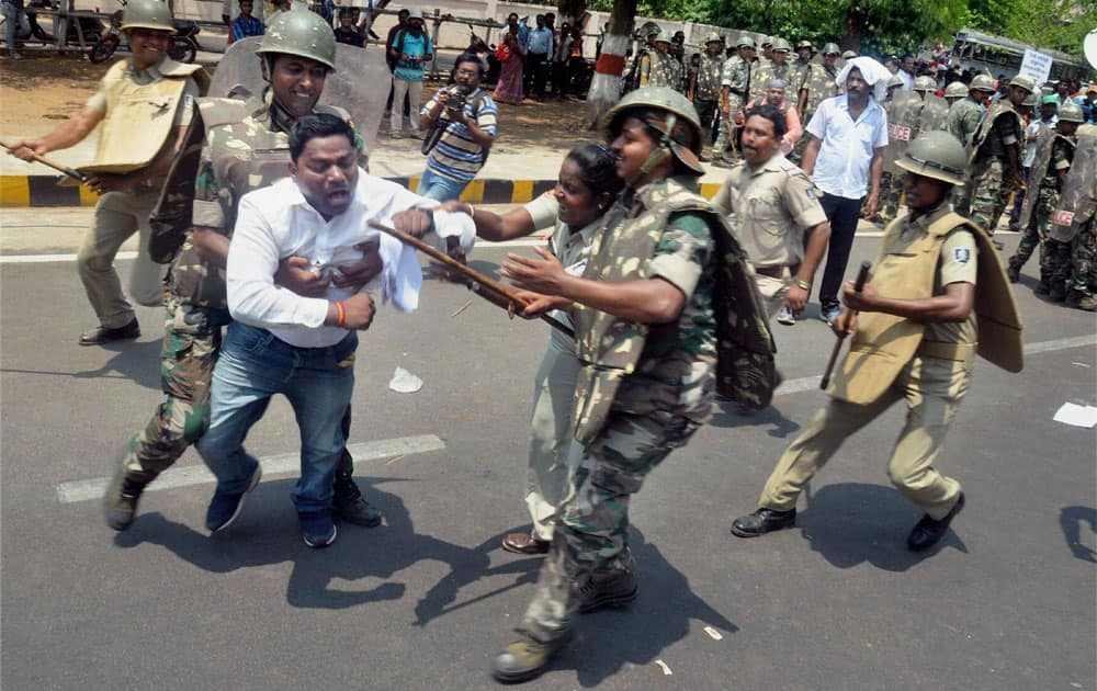 Police in action against BJP Yuva Morcha members during their assembly Gherao protest over unemployment in Bhubaneswar.