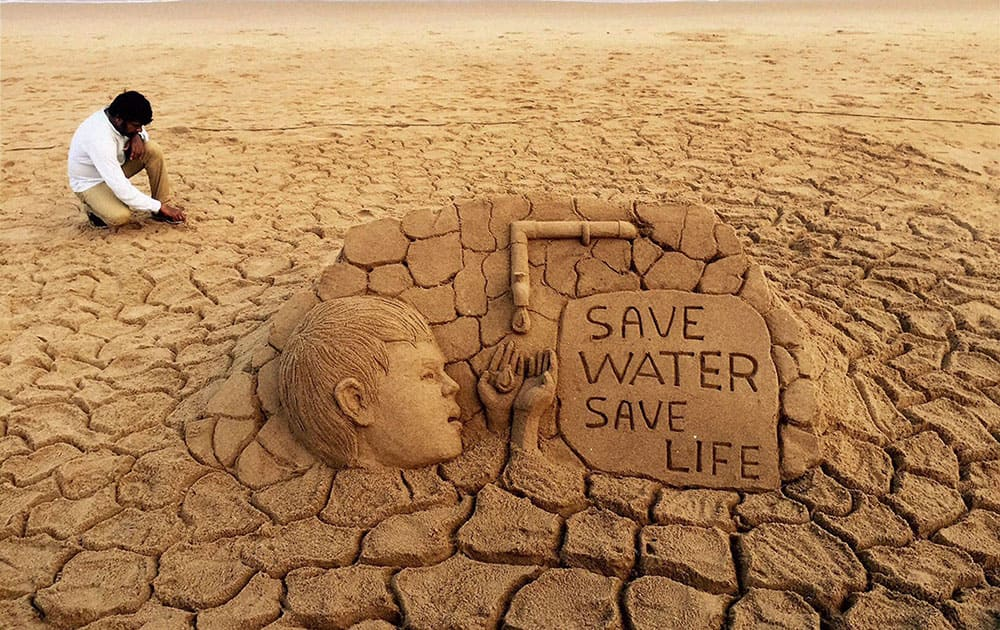 Renowned sand artist Sudarsan Pattnaik creates a sand art on water crisis with message Save Water, Save life at Puri beach of Odisha.