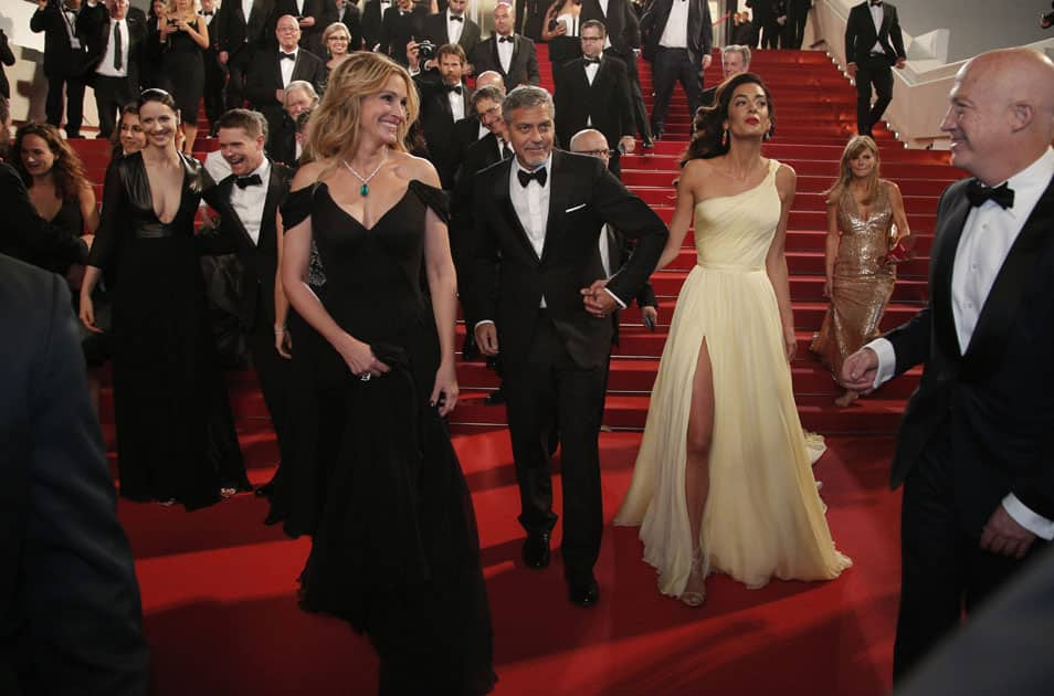 Actors Julia Roberts, George Clooney and Amal Clooney leave the screening of the film Money Monster at the 69th international film festival, Cannes, southern France.
