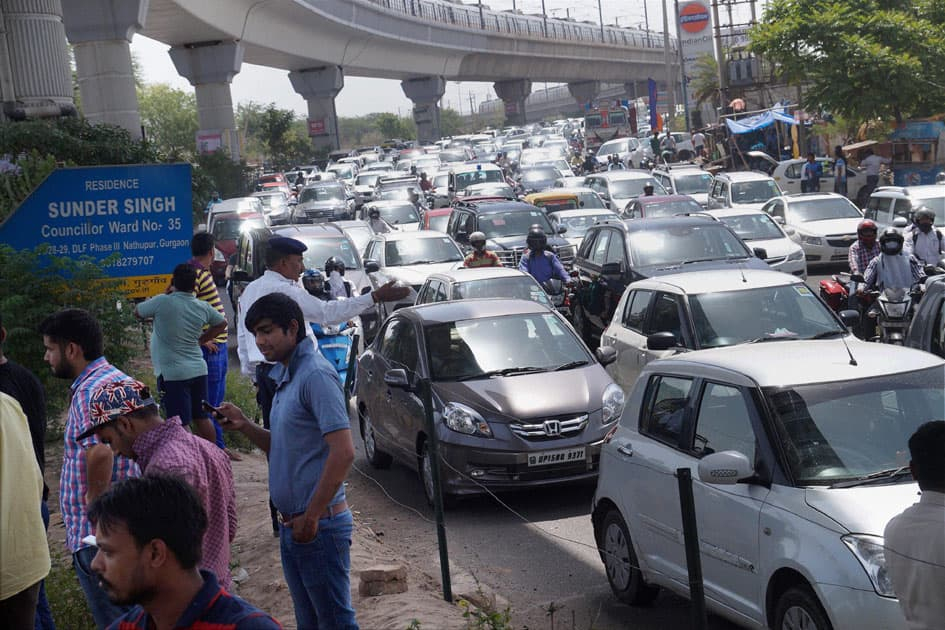 Villagers of Nathupur jam the traffic for water and proper electricity near Guru Dronacharya Metro station in Gurgaon.