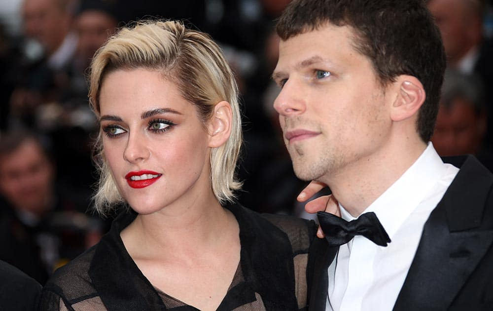 Actress Kristen Stewart, left and actor Jesse Eisenberg arrive on the red carpet for the screening of the film Cafe Society and the Opening Ceremony at the 69th international film festival, Cannes, southern France.