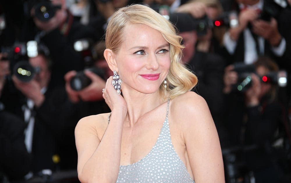 Actress Naomi Watts poses for photographers upon arrival for the screening of the film Money Monster at the 69th international film festival, Cannes, southern France.