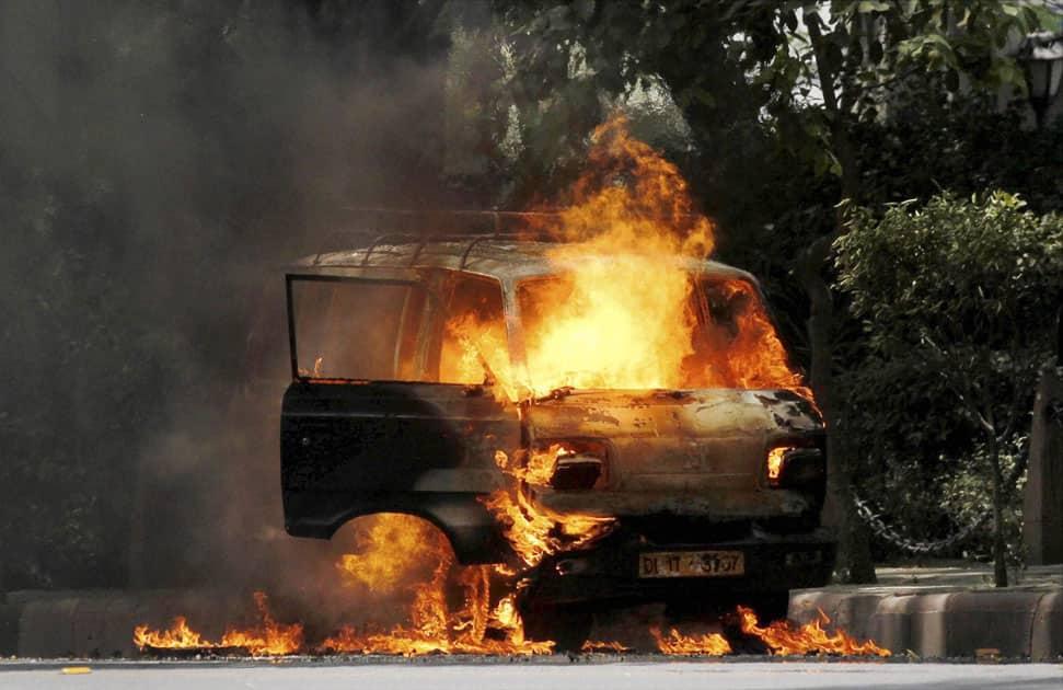A car that caught fire at Parliament Street, in New Delhi.