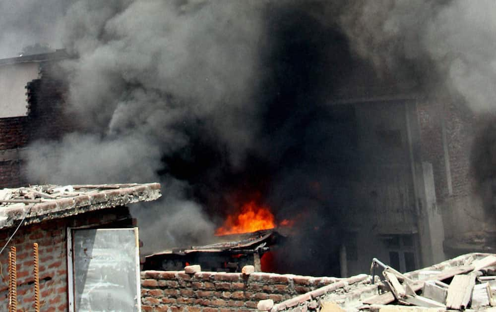 Smoke billowing out of a hardware store where a fire accident occurred, in Jammu.