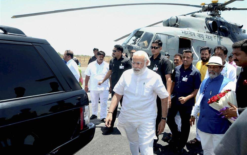 Prime Minister Narendra Modi arrives at the Indore airport on Saturday. The PM was on his way to attend the Simhastha International Vichar Maha Kumbh, an international conference on Living The Right Way, at Ninora village in Ujjain.