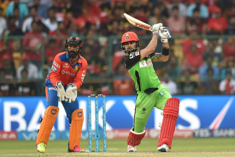 Royal Challengers Bangalore Virat Kohli plays a shot during the IPL T20 match against Gujarat Lions in Bengaluru.
