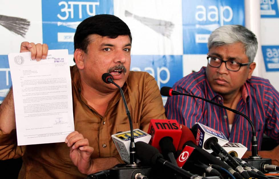 AAP leader Sanjay Singh speaks at a press conference on the issue of Prime Minister Narendra Modis educational degree as his party colleague Ashutosh looks on at the party office.