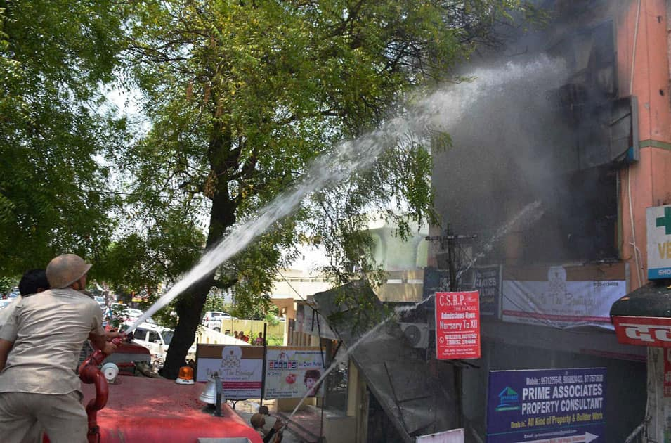 Firefighters trying to douse a fire at a branch of IndiaMart at Rajnagar Sector 14, in Ghaziabad.