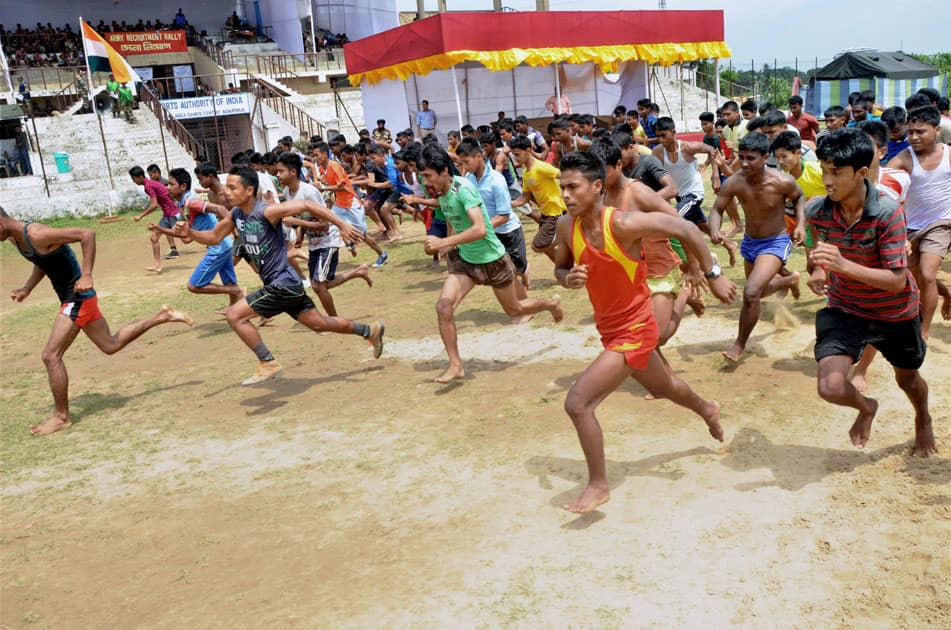 Potential recruits to the Indian Army running during a physical fitness test at a recruitment rally in Agartala on Sunday.