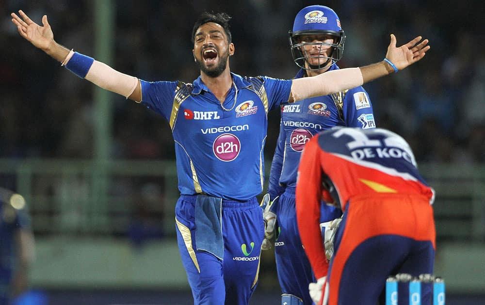 Krunal Pandya of Mumbai Indians celebrates the wicket of Quinton de Kock of Delhi Daredevils during IPL 2016 match in Visakhapatnam.
