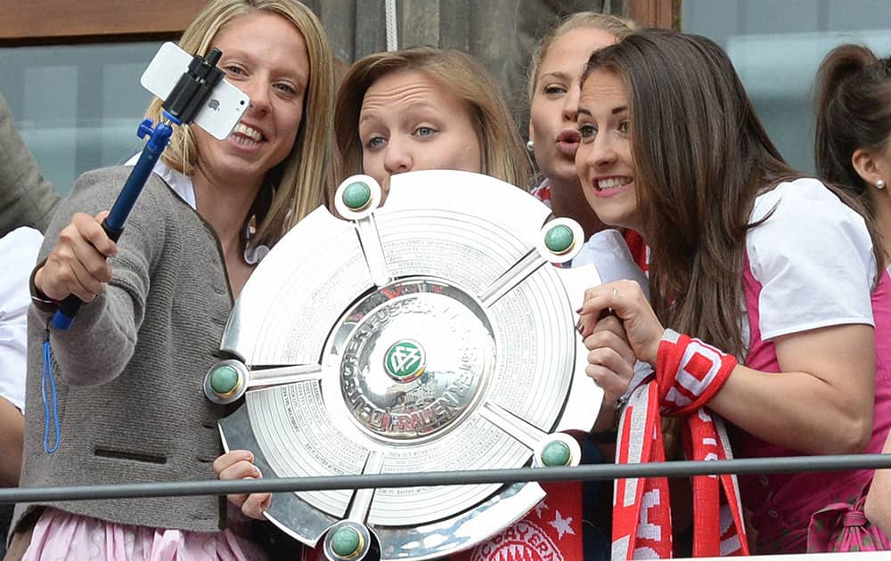 The womens team of Bayern Munich takes a picture during celebrations on the balcony of the city hall in Munich. Men and women teams of Bayern Munich became German soccer Champion.