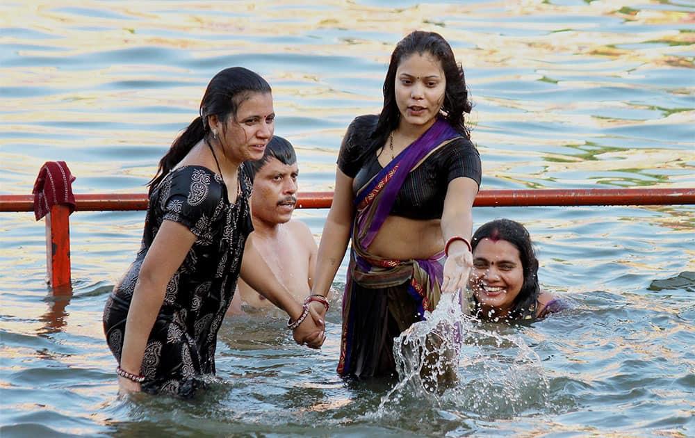 Devotees take bath in Kshipra River during Simahastha Mahakumbha Mela in Ujjain, Madya Pradesh.