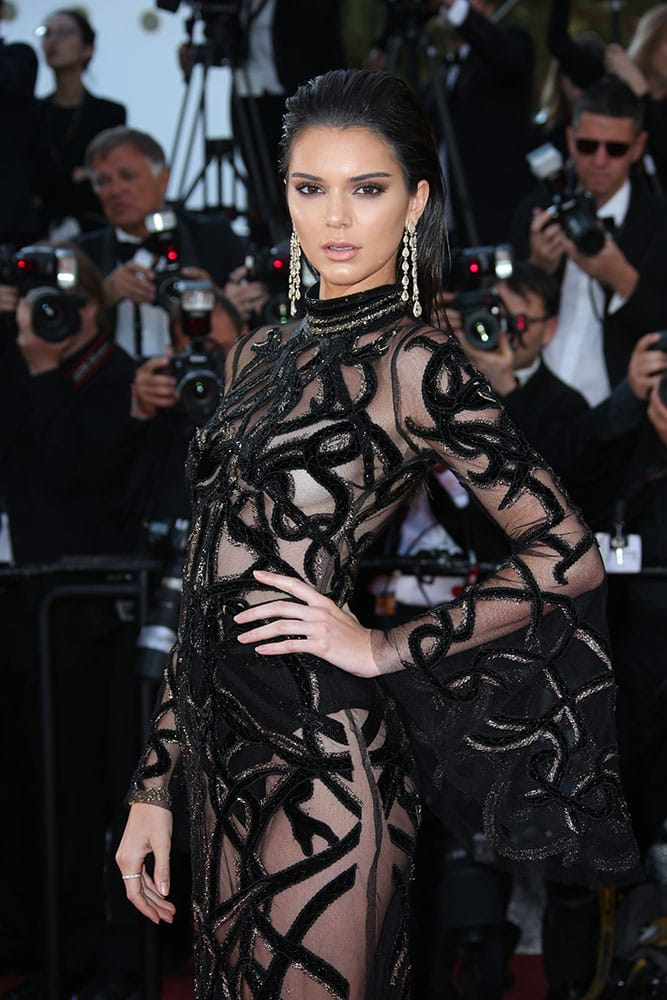 Model Kendall Jenner poses for photographers upon arrival at the screening of the film Mal De Pierres at the 69th international film festival, Cannes, southern France.