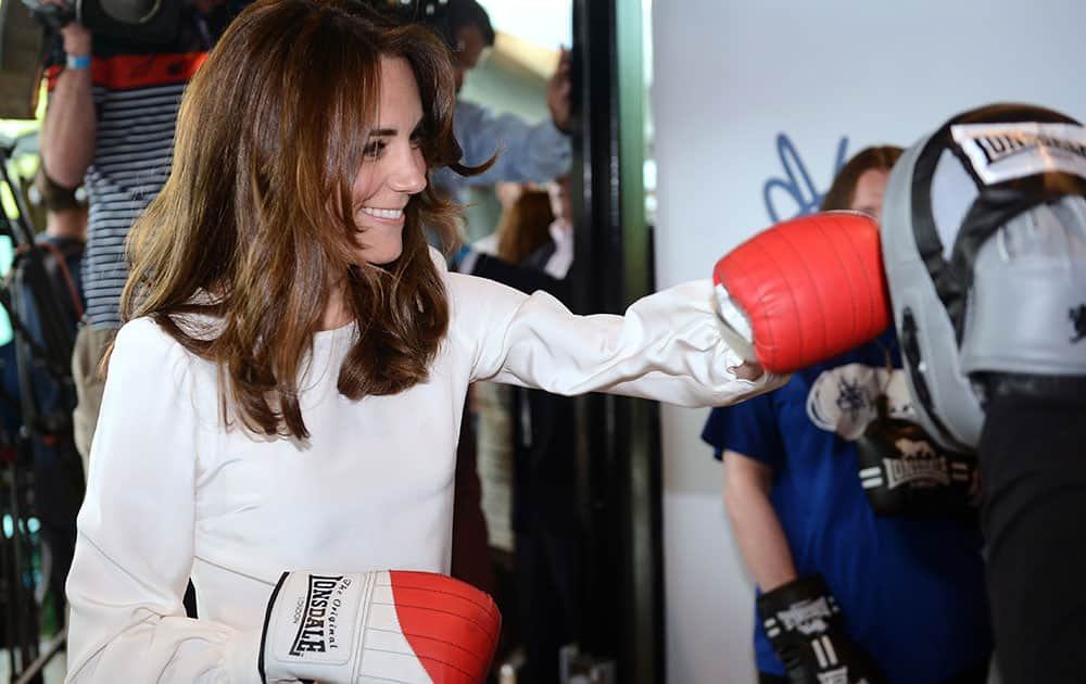 Kate, the Duchess of Cambridge, boxes with former boxer Duke McKenzie during the launch of Heads Together, the ambitious new campaign to end stigma on mental health, at the Olympic Park in London.