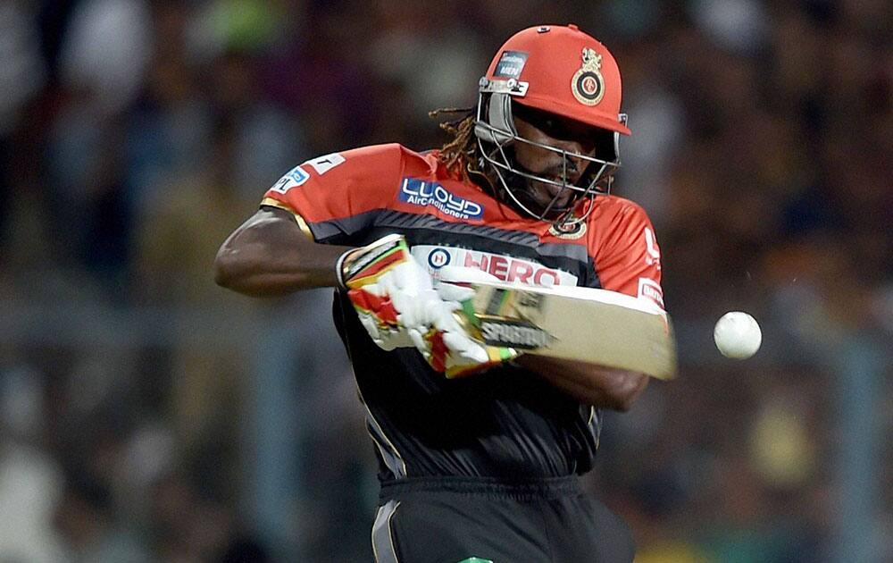 RCB batsman Chris Gayle plays a shot during an IPL match against KKR at Eden Garden in Kolkata.