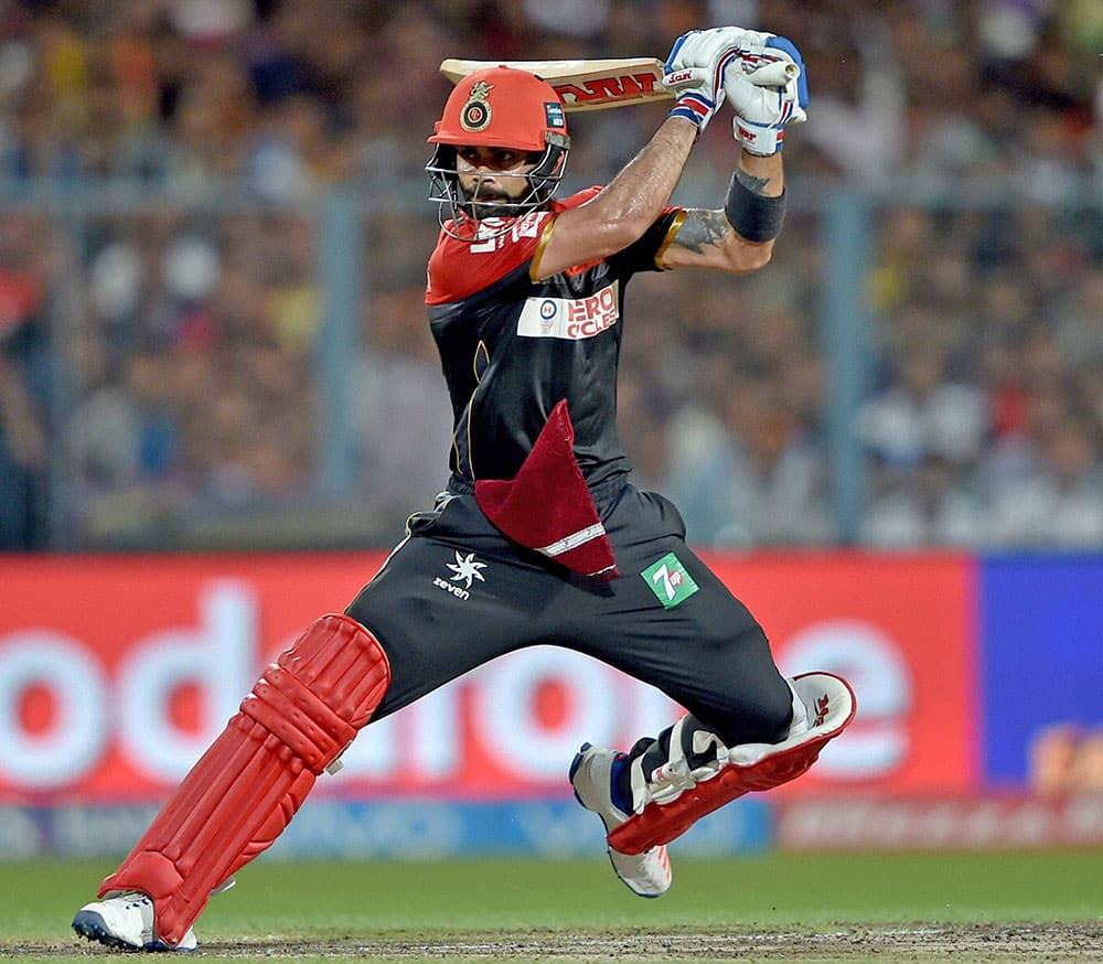 RCB batsman batsman Virat Kohli plays a shot during an IPL match against KKR at Eden Garden in Kolkata.