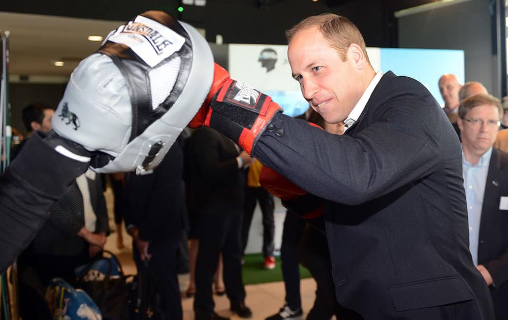 Britain's Prince William boxes with former boxer Duke McKenzie during the launch of Heads Together, the ambitious new campaign to end stigma on mental health, at the Olympic Park in London.