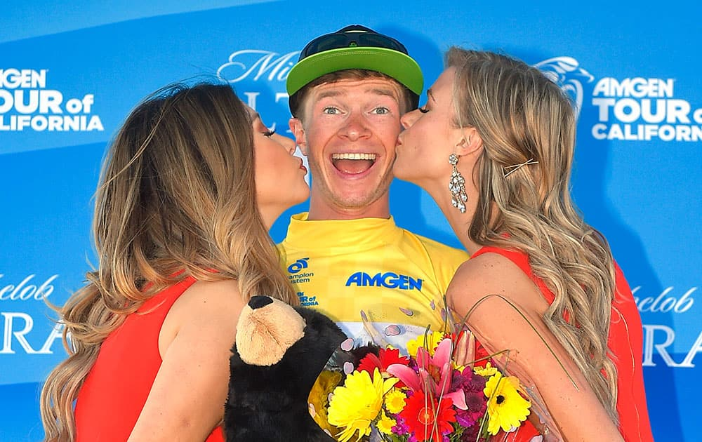 Benjamin King is kissed after receiving the gold jersey following his win in Stage 2 and becaming the overall leader of the Amgen Tour of California cycling race in Santa Clarita, Calif.