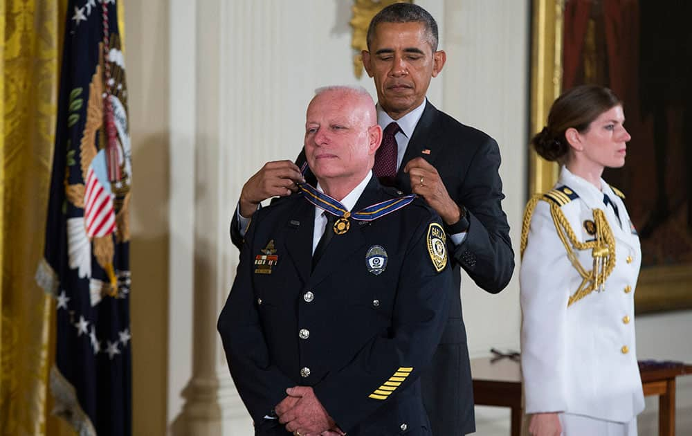President Barack Obama presents the Medal of Valor to Garland, Texas Police Department Officer Gregory Stevens during a ceremony in the East Room of the White House in Washington.