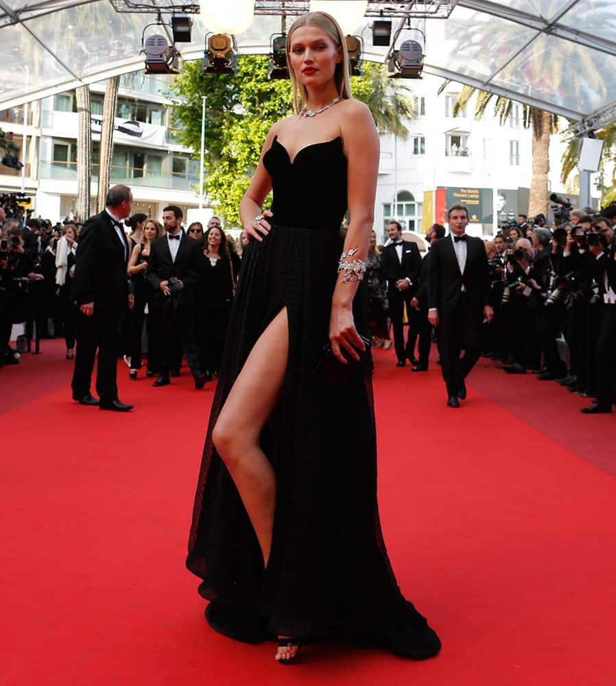 Model Toni Garrn poses for photographers upon arrival at the screening of the film Loving at the 69th international film festival, Cannes.