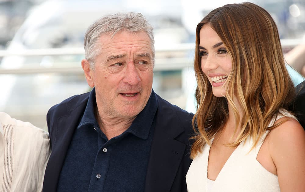 Actor Robert De Niro, left and actress Ana De Armas, pose for photographers during a photo call for Hands of Stone at the 69th international film festival, Cannes, southern France.