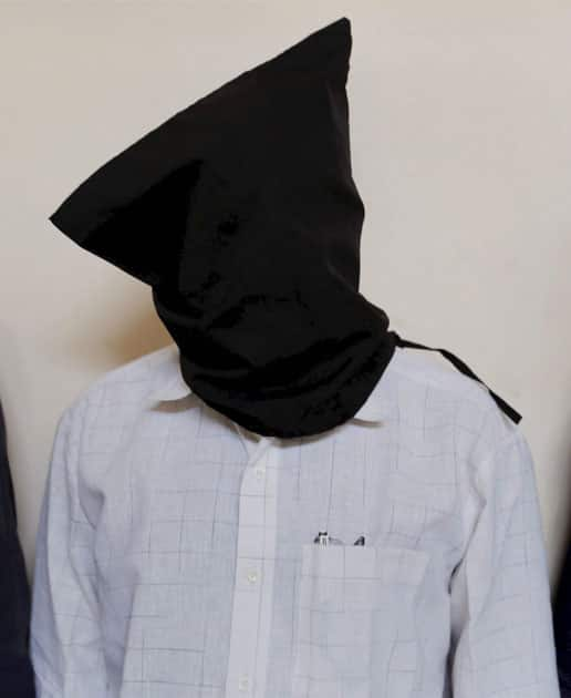 Farooq Bhana, a man accused of plotting the February 2002 attack on the Sabarmati Express in Gujarats Godhra that killed 59 people, at a press conference at ATS headquarter in Ahmedabad.