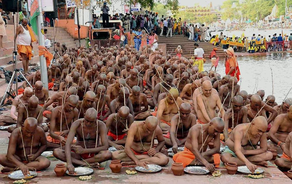 Sadhus of Niranjani Akhara take part in a Diksha ceremony at the banks of holy river Kshipra during Simhastha Maha Kumbh Mela in Ujjain, Madhya Pradesh.