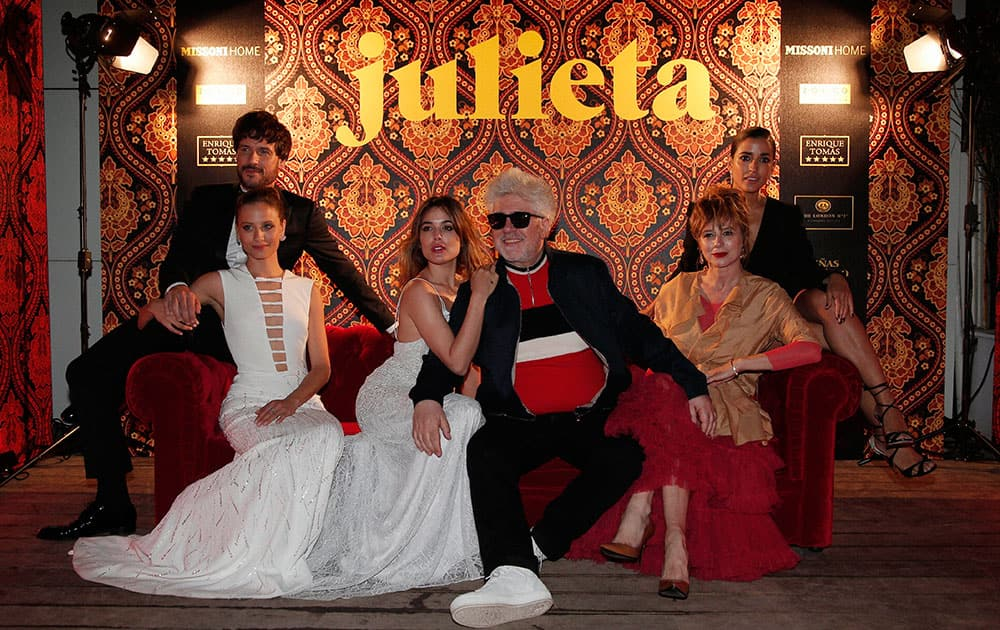 Actors Daniel Grao, from left, Michelle Jenner, Adriana Ugarte, director Pedro Almodovar, Emma Suarez and Inma Cuesta pose for photographers at the party for the film Julieta at the 69th international film festival, Cannes.