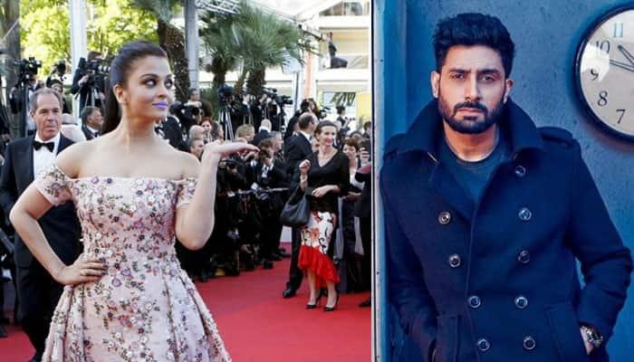 Purple or no purple on lips, Abhishek Bachchan still SMITTEN by wife Aishwarya Rai