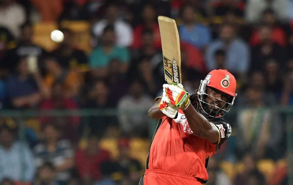 Royal Challengers Bangalores Chris Gayle plays a shot during an IPL match against Kings XI Punjab at Chinnaswamy Stadium in Bengaluru.