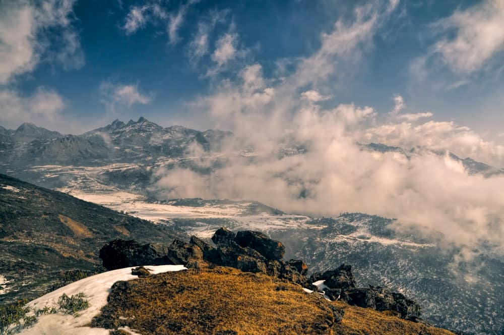 The panoramic view of the mighty Himalayan mountains through the clouds.