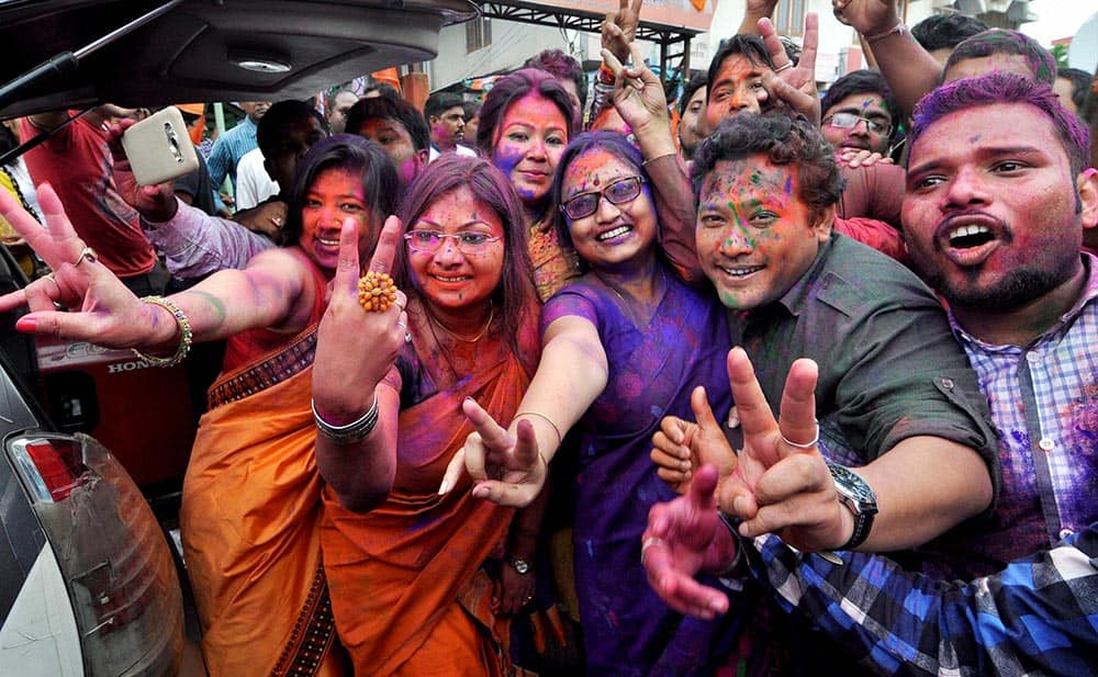 BJP workers dance as they celebrate their win in Assam Assembly election 2016 at Hengrabari in Guwahati.